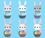 Conejitos de pascua lindos con los huevos Imagen de archivo