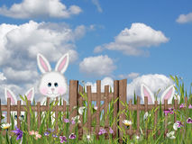 Conejitos de pascua que ocultan en hierba Fotografía de archivo libre de regalías