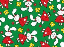 Conejitos rojos y margaritas amarillas Imagen de archivo libre de regalías