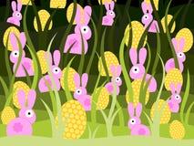 Conejitos y huevos coloridos Foto de archivo libre de regalías