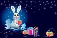 Conejo blanco con los regalos Fotos de archivo libres de regalías