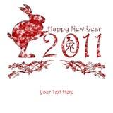 Conejo chino del Año Nuevo que sostiene 2011