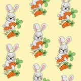 Conejo con el modelo de la zanahoria Fotografía de archivo libre de regalías
