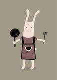 Conejo de la historieta con un sartén y un cepillo a disposición Ilustración del vector Imagen de archivo