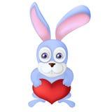 Conejo de la historieta que sostiene el globo rojo del corazón Liebres con Foto de archivo
