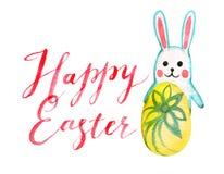 Conejo de Pascua con el huevo y poner letras a pascua feliz, ejemplo de la acuarela Imagen de archivo