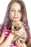Conejo del abarcamiento de la muchacha Imágenes de archivo libres de regalías