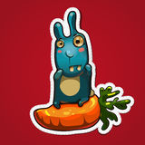 Conejo en zanahoria grande Fotos de archivo libres de regalías
