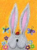 Conejo lindo en el resorte con el ladybug en su cabeza