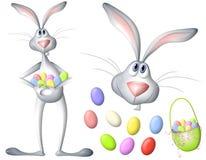 Conejo y huevos de conejito de pascua de la historieta Foto de archivo