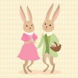Conejos con los huevos en busket Imagenes de archivo
