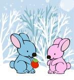 Conejos en tarjeta del invierno del amor Imagen de archivo libre de regalías