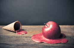 Coneptual image of apple Ice Cream Cone. Conceptual photo of a melting apple Stock Images