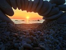 Conero Park, Ancona, Italy. Sirolo beach in the lights of a sunrise Stock Images