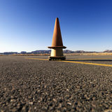 Cones on Airport Tarmac. Stacked safety cones on an airport tarmac in a rural landscape. Square shot royalty free stock images