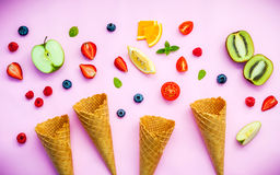 Cones and colorful various fruits raspberry ,blueberry ,strawber Royalty Free Stock Images