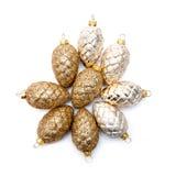 Cones de abeto dourados Fotografia de Stock Royalty Free