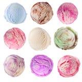 Cones de gelado da morango, do chocolate, da baunilha e do pistachio sobre o fundo branco Imagens de Stock