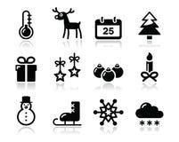 Ícones do preto do inverno do Natal ajustados Imagens de Stock