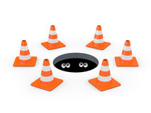 Cones do tráfego em torno de uma câmara de visita Foto de Stock Royalty Free