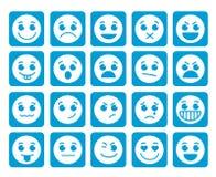 Ícones do vetor da cara do smiley em botões azuis lisos quadrados com emoções Fotografia de Stock