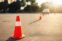 Cones for the examination, driving school concept. Lesson for novice car drivers, test for beginner royalty free stock photos