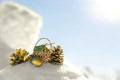 Cones, gifts and christmas balls in the snow Royalty Free Stock Images