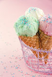 Cones of ice cream on pink background Royalty Free Stock Photos