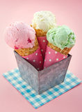 Cones of ice cream on pink vintage background Stock Image