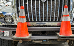Cones marker. On a truck in a village road on a sunny day Stock Image