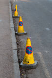 Cones with No Parking Sign. Three Cones with No Parking Sign on the Street royalty free stock images