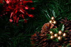 Cones placed on green fir with red decoration star Royalty Free Stock Photography