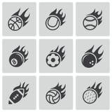 Ícones pretos das bolas do esporte do fogo do vetor ajustados Imagens de Stock Royalty Free