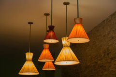 Cones shaped vintage retro style electrical ceiling lights at night. Great closeup view of cones shaped vintage retro style electrical ceiling lights at night Stock Photo