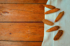 Cones on a wooden background Royalty Free Stock Images