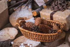 Cones in a wooden basket Royalty Free Stock Photos