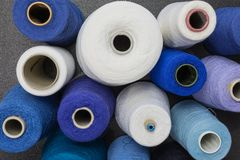 Cones of wool. And cotton yarn in white, turquois and blue stock photos