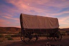 Conestoga wagon. A Conestoga wagon at sunset in Idaho royalty free stock image