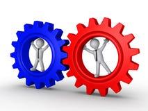 Conexão de duas equipes diferentes da roda denteada Fotografia de Stock Royalty Free
