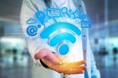 conexão do símbolo do wifi cercada pelos multimédios e pelo Internet app Foto de Stock