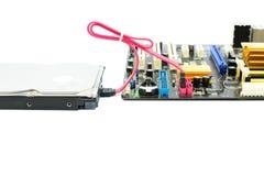 Conexión del disco duro y del sata en la placa madre Imágenes de archivo libres de regalías