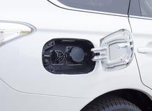 Conexión del enchufe del coche eléctrico Imagen de archivo libre de regalías