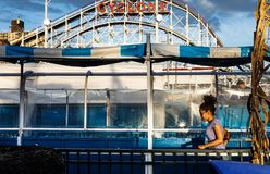 Coney Island Beach in NYC. NEW YORK, USA - Sep 23, 2017: Coney Island Beach in NYC. People have fun on water atarcions Wild River. Coney Island is well known as stock photos