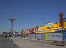 Coney Island Boardwalk with Parachute Jump in the background royalty free stock images