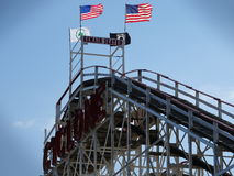 The Coney Island Cyclone 82. The Coney Island Cyclone (better known as simply the Cyclone) is a historic wooden roller coaster that opened on June 26, 1927, in Stock Photos