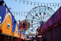 Coney Island, NY: Ferris wheel and string lights stock image