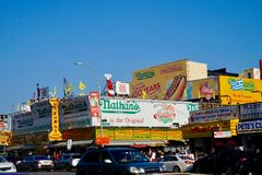 Coney Island, NY - 08/5/2018: Nathan`s Famous hot dog stand. At Coney Island in New York, NY. Street view of the food chain logo on the outside banner sign stock photos