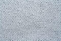 Confecção de malhas da textura da tela da camiseta ou do lenço grande Fundo feito malha do jérsei com um teste padrão de relevo M Imagem de Stock Royalty Free