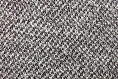 Confecção de malhas preto e branco ou teste padrão feito malha Backg da textura da tela Fotos de Stock