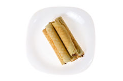 Confection rolls with cooked condensed milk on a white background Royalty Free Stock Images